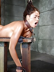 Busty brunette chained and shackled