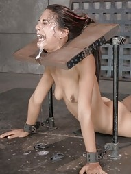 Sexy brunette strictly restrained in stocks
