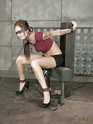 Nubile teen shackled in chains
