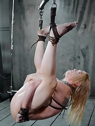 Big titted slut is hung by her ankles