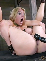 Big titted slut is hung by her ankles, pic #1