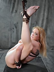 Big titted slut is hung by her ankles, pic #7